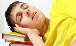 Teenager sleep on the Books