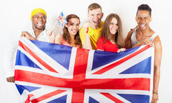 Group of multiracial people holding a England flag